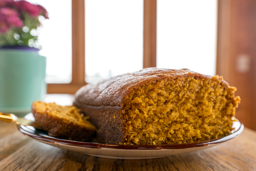 close up picture of pumpkin bread with gold knife